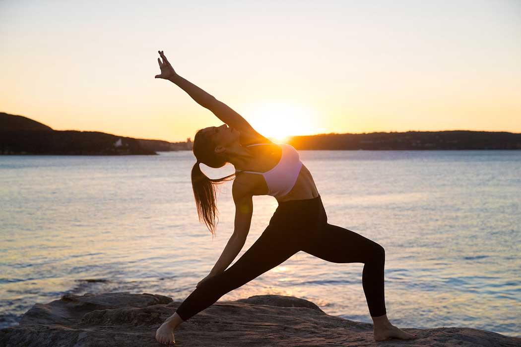 Yoga stretching on the beach